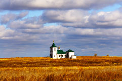Single Church. Lonely rural church on a background of the autumn sky Stock Photos
