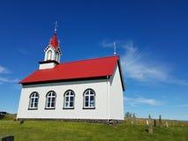 Single church in green field blue sky Stock Photos
