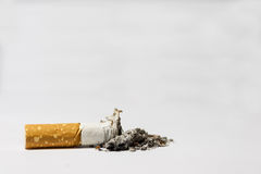 Single cigarette butt Royalty Free Stock Photo