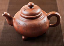 Teapot on table Royalty Free Stock Image