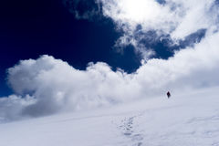 Single climber in the mountains rise. Climber in the mountains rise, clouds Royalty Free Stock Photos