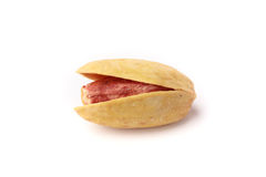 Single closeup isolated pistachio nut. With its shell on a white background Royalty Free Stock Photography