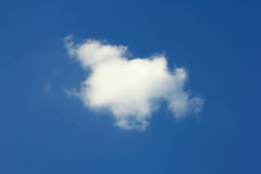 Single cloud in blue sky. Stock Photo
