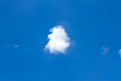 Blue sky with clouds. Single Cloud in the blue sky royalty free stock photos