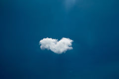 A single cloud in the blue sky Stock Images