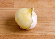 Single Clove Garlic – Half Peeled. Half peeled fresh single clove garlic, also known as pearl garlic or solo garlic, is a variety of Allium ampeloprasum native Royalty Free Stock Images