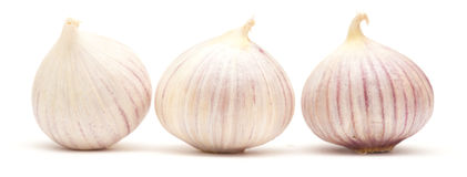 Single clove garlic Stock Images