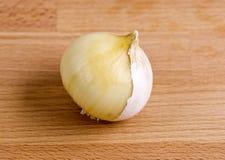 Single Clove Garlic – Half Peeled Royalty Free Stock Images