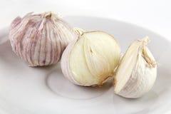 Single clove garlics Stock Images