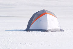 Single color tent in snow desert Stock Photo