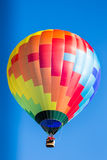 Single colorful hot air balloon in flight. Flame propane Royalty Free Stock Photography