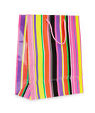 Single colorful striped paper shopping bag Stock Photos