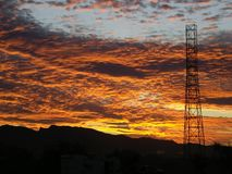 A Single Communications Tower at Sunset Stock Photos