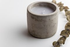 Single concrete candle with essential oils. Minimalism concept. Spa stock photo
