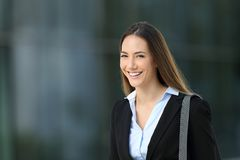 Confident executive looking at you on the street. Single confident executive looking at you standing on the street Stock Photo
