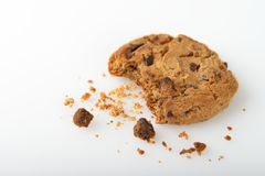 Single Cookie with a Bite and Crumbs  on a White Background Royalty Free Stock Image