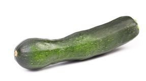 Single Courgette isolated on white. Stock Photos