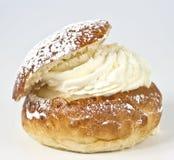 Single cream bun with almond paste. Cream and vanilla powder Royalty Free Stock Photography