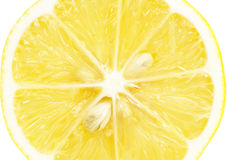 Single cross section of lemon Royalty Free Stock Photos
