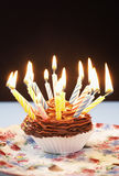 Single Cupcake With Birthday Candles Royalty Free Stock Photo