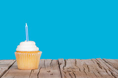 Single cupcake with blue candle Stock Photo