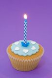 Single cupcake with candle Stock Photos