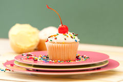 Single Cupcake With A Cherry On Top. On A Pink Plate Royalty Free Stock Photography