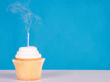 Single cupcake with smoke candlle Royalty Free Stock Photo