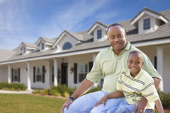 Single Dad and Son In Front of Home stock photo