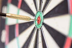 Single Dart Stuck in a Bullseye Board Royalty Free Stock Photography