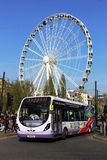 Single deck bus, Manchester in front of big wheel Royalty Free Stock Images