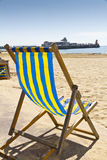 Single deck chair on the beach Stock Photography