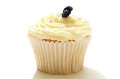 Single decorated cup cake on white Royalty Free Stock Photo