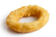 Single deep fried onion or calamari ring  on white. Royalty Free Stock Photography