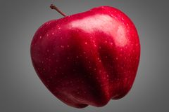 Single delicious red apple on grey background royalty free stock photography