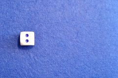A single dice with the number two. Displayed on the top Stock Photos