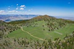 Dirt Road in Vast Wyoming Wilderness Stock Photos