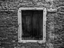 Single door in the street of Venice, Italy. A old door in the City of Venice in Italy, black and white royalty free stock photos