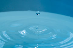 Single drop of rain light blue. High speed photo of waterdrop Stock Photography