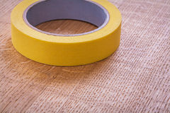 Single duct tape on vintage brown wooden board Stock Photography