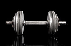 Single Dumbbell on Black Stock Image