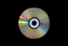 Single DVD-RW disc on black . Royalty Free Stock Photography