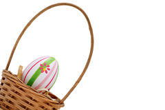 Single Easter egg into a basket Royalty Free Stock Image