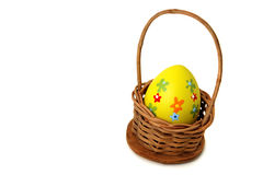 Single Easter egg into a basket Royalty Free Stock Photo