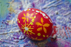 Single easter egg with beautiful  color abstract pattern,  on colored textured background Royalty Free Stock Image