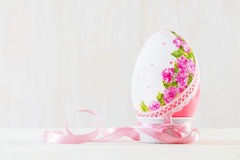 Single easter egg on wooden table. Decoupage art Royalty Free Stock Images