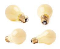 Single electric bulb lying on its side, isolated over the white background Stock Photos