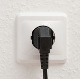 Single electric socket with plug Stock Photo