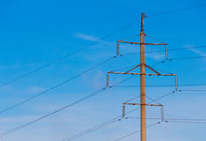 Single electric transmission tower. Concrete column. Stock Images