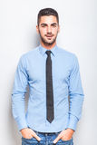 Single elegant man in blue shirt with black tie Royalty Free Stock Photography